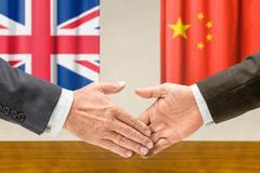 Representatives of the uk and china shake hands Stock Photos