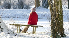 A woman resting on a bench - stock footage