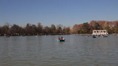 People Sailing On Small Boats At Pond In Retiro Park Stock Footage
