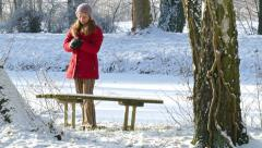 A woman throws a snowball - stock footage