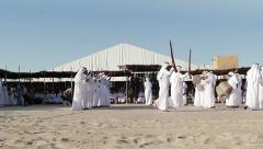 Wide shot of bedouin traditional dance in front of guests Stock Footage