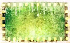 Grunge green film strip frame - stock illustration