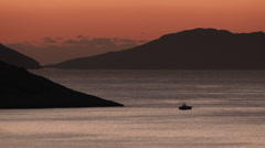 Scenery, silhouette of fishing boat/trawler in the sea at sunrise Stock Footage
