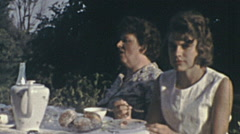 East Germany 1960's: mother and daughter eating outdoor Stock Footage
