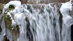 Waterfall in the National Park Slovak Karst, in the village named Haj in winter Stock Footage