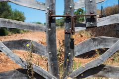 crooked wooden  gate - stock photo