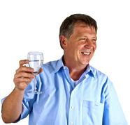 thirsty man drinking out of a wine glass - stock photo