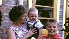 American Dream Mom Son and Baby Brother Vintage Film Home Movie 8092 Stock Footage