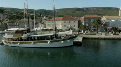 Aerial pan, of wooden Boat and marina dock Stock Footage