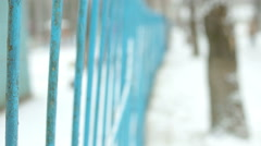 Snow on the blue fence Stock Footage