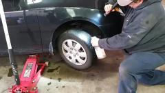 Car Tire Being Sprayed - stock footage