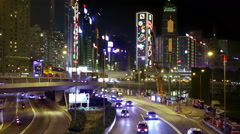 Hong Kong traffic intersection with tall Christmas lights illuminated buildings Stock Footage