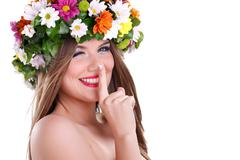 spring fairy with finger on lips - stock photo