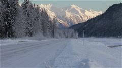 Old VW VanPassing on Wintry Alaska Highway Stock Footage