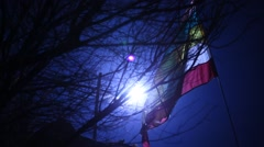 Flag waving lite at night wind Stock Footage