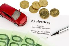 purchase contract for car - stock photo