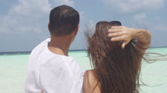 Couple In Love Observes Turquoise Maldivian Sea From Romantic Island Stock Footage