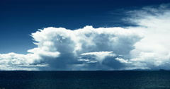 4k huge clouds mass on the lake namtso,Lingling shimmering tibet mansarovar. Stock Footage
