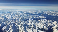 0598 UHD Aerial view of Alps, winter time - stock footage