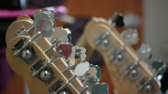 Guitars stock tight shots sitting in rack.mp4 Stock Footage