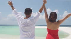 Multicultural Honeymoon Couple Embraces Lovingly On Romantic Island Of Maldives Stock Footage