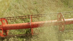 Harvester cropping wheat - stock footage