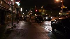 Truck driving night city street pan Stock Footage