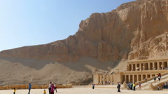 Tourists near ancient temple of Hatshepsut in Egypt Stock Footage