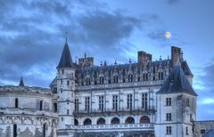 amboise castle with the moon above - stock photo