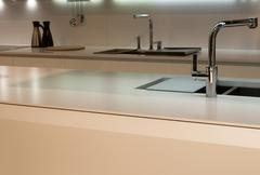 kitchen worktop and faucet - stock photo
