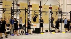 Leg raises on the bar during International crossfit competition Stock Footage