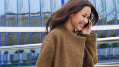 Beautiful, stylish, business woman talking on the phone outdoor Stock Footage