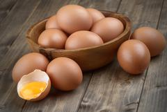 eggs in a wooden bowl - stock photo