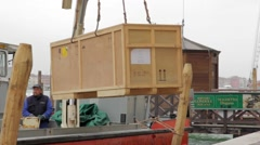 Artwork crate is unloaded from boat in Venice for the Art Biennale of Venice Stock Footage