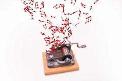 Music notes flying out of music box – white background Piirros