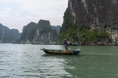 Fisherman in halong bay Stock Photos