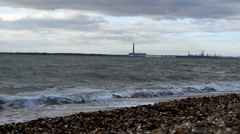 Lee-on-the-Solent stoney beach with Fawley on the horizon Stock Footage
