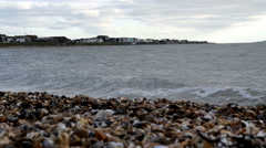 View of Lee-on-the-Solent from around the curved stoney beach. Calm sea Stock Footage