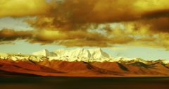 4k timelapse huge clouds mass over snow mountain,sunset reflection lake namtso. Stock Footage