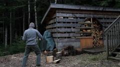 Man Splitting Firewood in Alaska Stock Footage