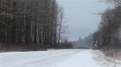 Truck Passing Away From Camera on Icy Winter Road Stock Footage