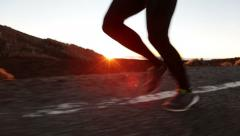 Running shoes and legs in action with male runner jogging - STEADICAM Stock Footage