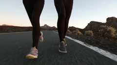Fitness people running - runners on mountain road training for marathon Stock Footage
