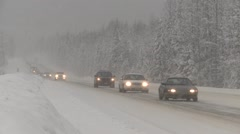 Snowy traffic on Rogers Pass long single line of cars Stock Footage