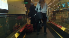Following People on a Travelator at an Airport Stock Footage
