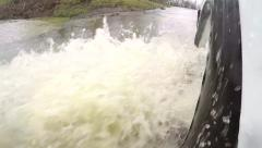 Super slow motion of tire driving through flood waters. Stock Footage