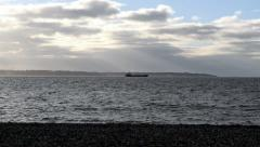 Empty container ship sailing towards Southampton seen from Lee-on-the-Solent Stock Footage