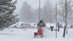 Man with Snowblower in Blizzard 4K Stock Footage