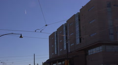 Establishment shot jet trail time lapse street lantern cables office building v2 Stock Footage