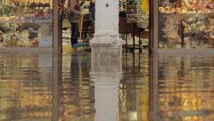 shopkeeper mops during flooding in venice: economic impact of climate change - stock footage